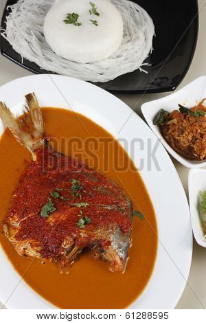 Top view of Goan Pomfret Curry - A spicy curry made of Pomfret fish and spices from Goa, Western India. poster