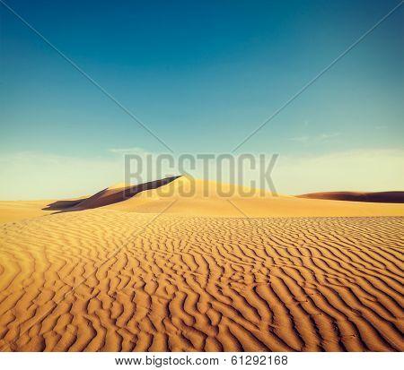 Vintage retro hipster style travel image of dunes of Thar Desert. Sam Sand dunes, Rajasthan, India