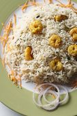 Prawn Biryani - Biryani, biriani, or beriani is a set of primarily South Asian rice-based foods made with spices,rice (usually basmati) and meat/vegetables. Prawn Biryani contains Prawns as a major ingredient poster