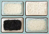 Four little dishes full of rice (from up right clockwise: Basmati Arborio Carolina gold Wild rice. It has a clipping path. poster