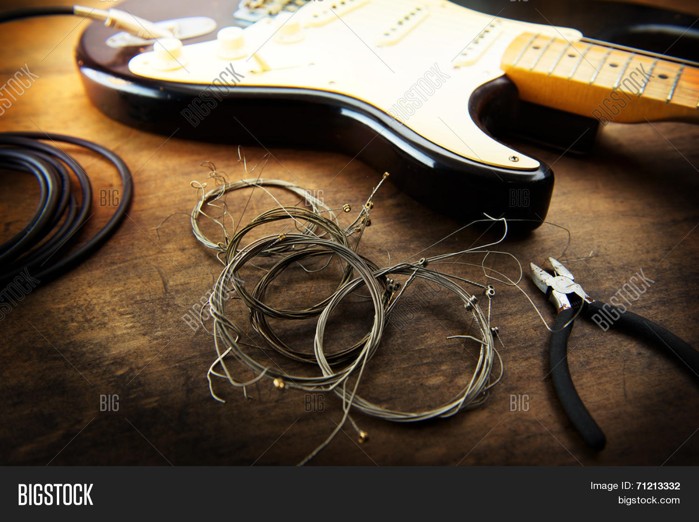 guitar maintenance image photo free trial bigstock. Black Bedroom Furniture Sets. Home Design Ideas