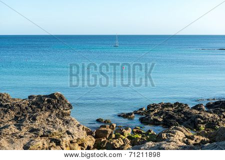 Cliffs And Sailing Boat, Le Loc'h Bay (france)