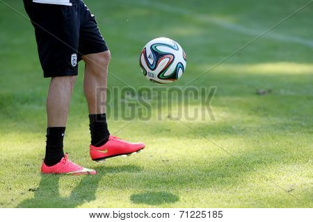 Footballer's Feet In Action With Greek Superleague Brazuca (mundial) Ball Field During The Training