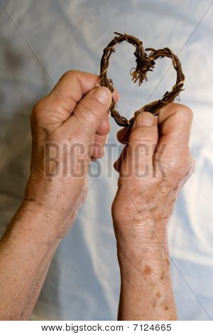 hands of grandmother with the heart