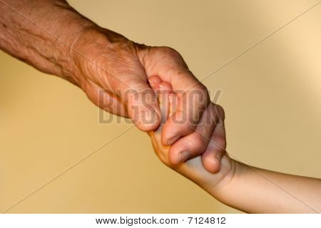 hand of old woman and child