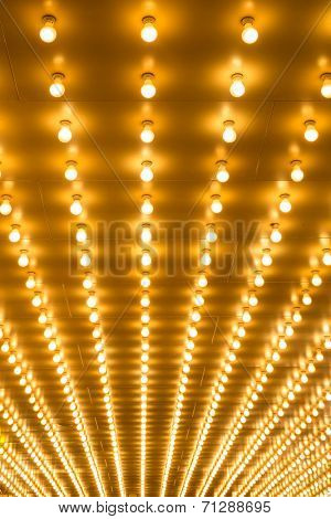 golden bulbs marquee lights background