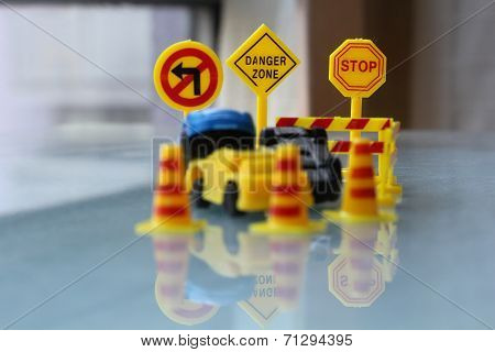Car Accident Zone Cordoned Off With A Yellow Stop Sign Post. Two Cars With A Major Collision