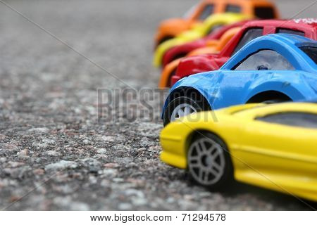 Miniature Colorful Cars Standing In Line On Road Sale Concept. Different Colored Cars - Blue, Yellow