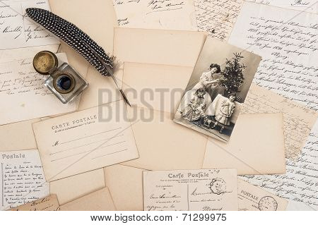 old letters vintage postcards and antique feather pen. nostalgic sentimental background with retro christmas postcard poster