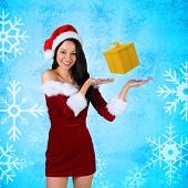 Pretty girl presenting in santa outfit against blue snow flake pattern design poster