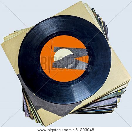 A pile of 45 RPM vinyl records used and dirty