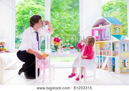 Father And Daughter Playing Doll Tea Party