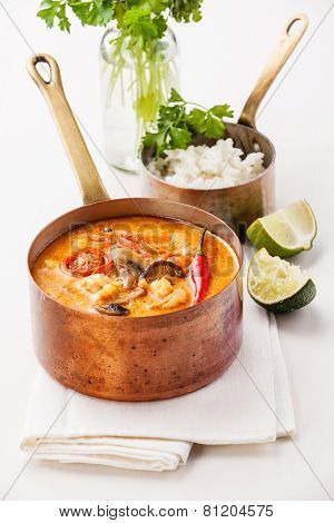 Spicy Thai Soup Tom Yam With Rice And Seafood On White Background