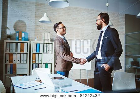 Successful businessmen handshaking after negotiation