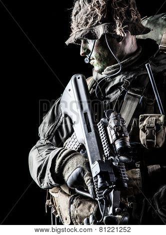 Jagdkommando soldier Austrian special forces with rifle on dark background poster