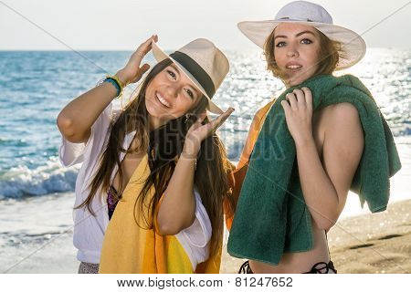 Attractive Ladies At The Beach On A Sunny Day.