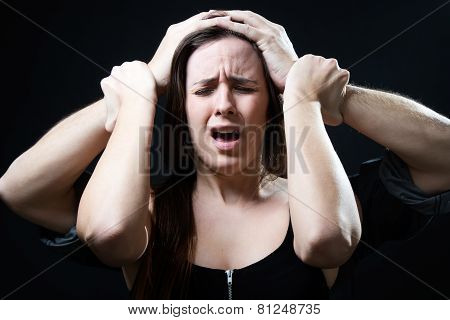 Young Woman With A Male Hands Pressing Her Head. Concept Of Oppression.