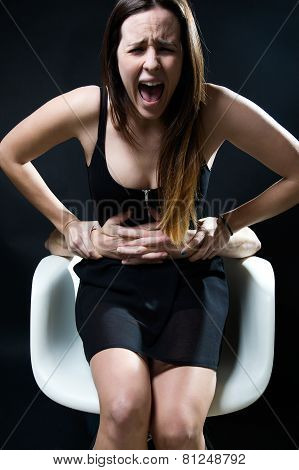 Young Woman In A Chair Caught By A Male Arms. Concept Of Oppression.