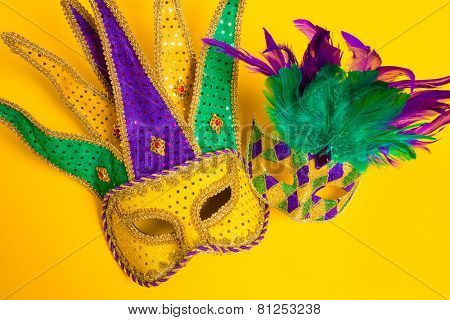 A group venetian, mardi gras mask or disguise on a yellow background