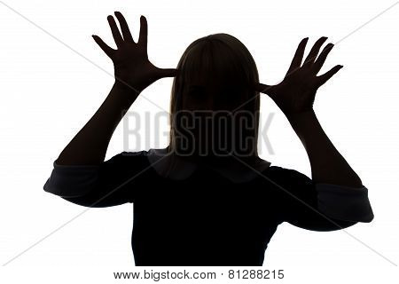 Silhouette of woman with palms on head