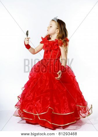 Cute Little Princess Dressed In Red Isolated On White Background