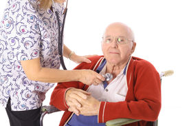 nurse checking elderly mans pulse
