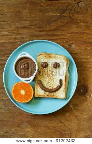 breakfast serving funny face on the plate (toast, chocolate spread) poster