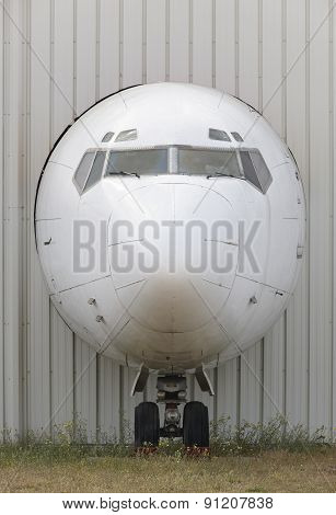 Aircraft Nose In An Industrial Plant Facade
