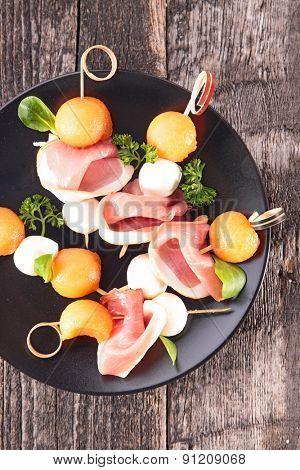 appetizer creative with melon,prosciutto and mozza
