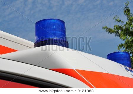 Flashing Blue Light On An Ambulance Car