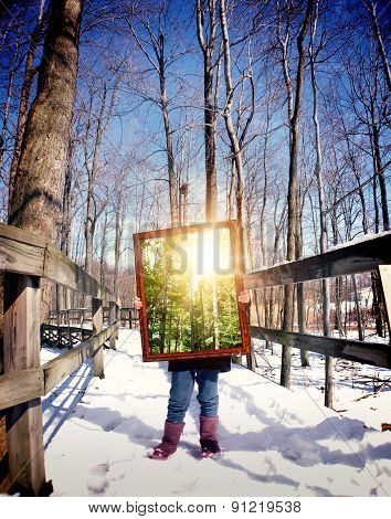 Winter Child Holding Piture Frame Of Summer
