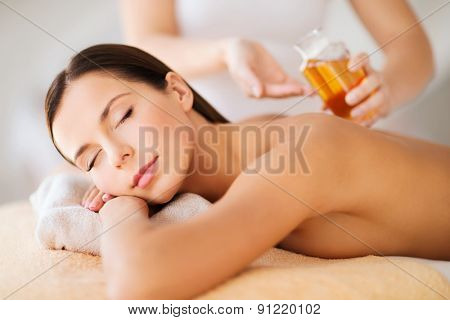 beauty, spa, resort and relaxation concept - beautiful woman in spa salon poster