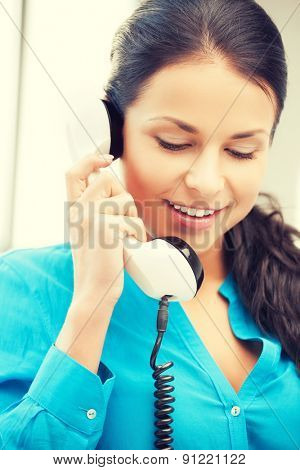 picture of businesswoman with rotary phone calling