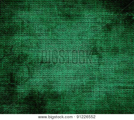 Grunge background of cadmium green burlap texture