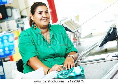 Portrait of seller assistant or cashdesk cashier worker teller in supermarket store