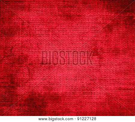 Grunge background of cadmium red burlap texture
