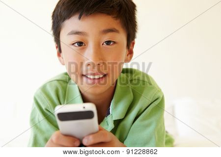 Young boy using smartphone