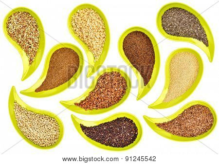 healthy, gluten free, grains and seeds (flax, chia, quinoa, kaniwa, sorghum, rice, buckwheat, amaranth, teff) - top view of teardrop shaped bowls on white background