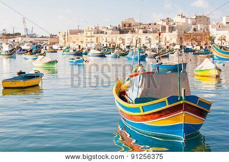 Colorful Typical Boats - Mediterranean Traditional Fisherman Village In The South East Of Malta.