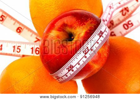 Three Oranges And Apple With Tailor's Ruler. Fruit Healhy Vitamin Diet Helps To Lose Weight.