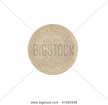 An old Spanish coin of 50 pesetas showing Franco dictator face isolated on a white background. 1957