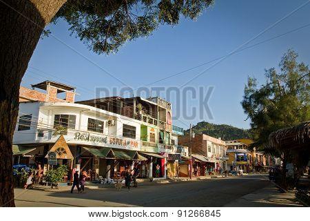 Main street view of Puerto Lopez, popular vacation spot in the Ecuadorian coast.