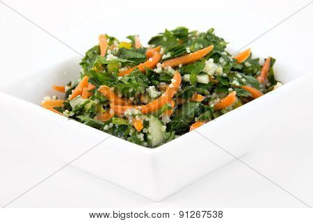 tabbouleh parsley and carrot salad bowl over white background