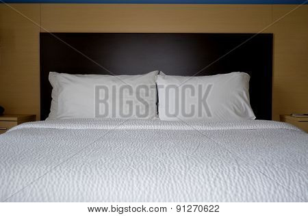 Bed, pillows and headboard