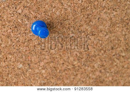 Single Thumb Tack On Cork Board