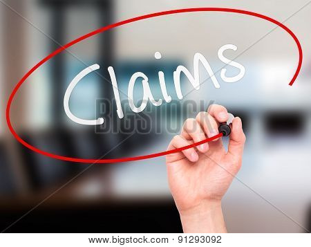 Man Hand writing Claims with marker on transparent wipe board.