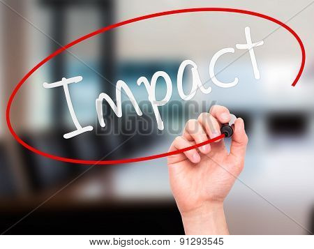 Man Hand writing Impact with marker on transparent wipe board.