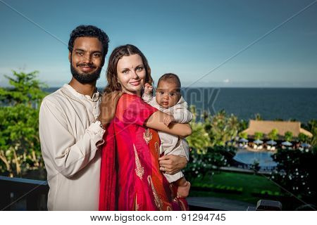 Happy Young Attractive Mixed Race Family with Newborn Baby