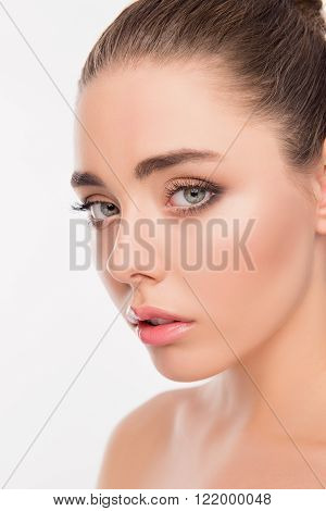 Close up portrait of pretty woman with eyes like gimlets