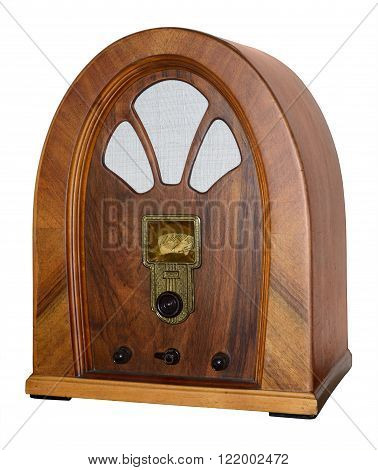 Old retro radio used at home isolated on white.